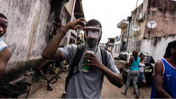 A Congolese man with a homemade gas mask during a protest in Kinshasa