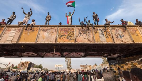 Demonstrators gathered near the Defence Ministry in Khartoum to demand democracy and civilian rule following the fall of President al-Bashir